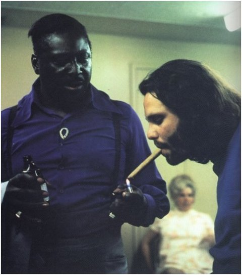 jim morrison getting a light from muddy waters